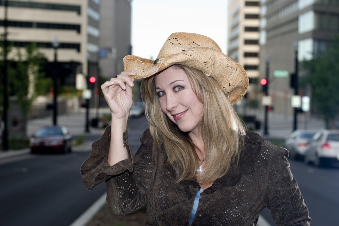 Holly wearing a cowboy hat in downtown Nashville