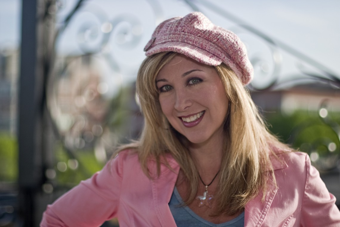 Holly wearing pink and a pink hat